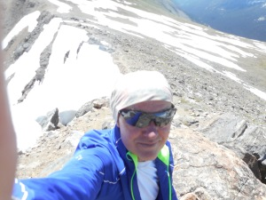 """By now, 10am, I had earliier turned over leadership of the trip to my co-leader Jordan Holquist because I still had a cold, and was moving slow; at this point they were far ahead. This was near my high point on S Arapaho, near 12,700. But I was feeling the """"lassitude from the altitude"""", and turned around. Fortunately, I had a pair of radios, and gave one to Jordan. Chris Marotta also had a radio, tuned to our channel. These worked quite well despite the alpine environment, and were key to coordinating during a mishap on the return leg of the trip."""